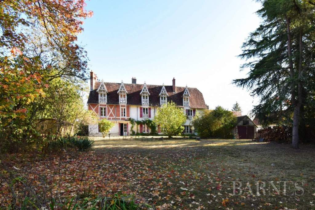 Happy Wednesday! Today's house is such a massive opportunity to own your own estate in France, for less than $500K USD! The property comes with an eight-bedroom manor house, a mill along the side of a river, a guest house, a barn, a woodshed, and nearly two acres of serene parkland. This has amazing potential as a bed and breakfast, or simply an enormously generous family home. The living room hearth, tiles, and beams are lovely, and I typically don't feature bathrooms, but that tub by the sunny window looks really lovely! It looks like some renovations have already been completed, with some more modern finishes on some rooms. Does this property inspire you to dream a little
