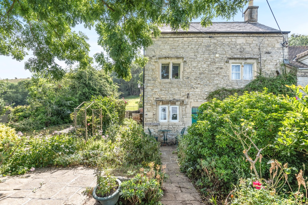 Tucked away on a quiet lane in the most desirable location of Selsley stands this delightful two bedroom grade II listed cottage benefiting from parking and an extensive garden with panoramic views.  On entering there is a nice size kitchen with plenty of built in units enjoying views out to the garden. Following through into the sitting room there is a cotswold stone feature fireplace, a stone staircase leading up to the first floor and double doors leading through to a good size dining room. The dining room enjoys plenty of light and from here you can access out into the garden. Also on the ground floor there is a cloak room and separate utility area. To the first floor there is a spacious family shower room and a double bedroom with views looking out. To the second floor there is a lovely spacious attic bedroom with a storage cupboard.