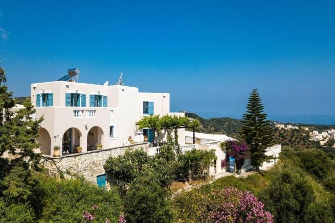 This beautiful villa sits amongst olive groves in a very quiet location in Pano Stalos. There is a fantastic view to Chania, Agia Marina and the sea.  The villa has 3 double bedrooms and 3 bathrooms. It has a cozy newly renovated living room with fireplace and open kitchen with Italian furniture. There is air conditioning in every room. The viilla has 3 spasious balconies with stunning views. Outside areas inlcude cozy patios with barbecue. There is also a dining area for 6 persons. The large swimming pool (with heating possibility) of 55m2 has also a children's pool. Parking space for 3 cars. The villa has EOT license and is being rented out successfully.  Stalos is located just 7.5 km from the exceptionally beautiful Venetian Harbor of Chania, opposite the island of St. Theodore and just a short time away from famous beaches such as Balos and Elafonisi.  It is a village which has been built in two sections, the mountainous part and the coastal part of the village, the Pano Stalos (upper Stalos) and Kato Stalos (lower Stalos). In this area you can enjoy the sandy beach and clear waters of the sea, and the beauty of Cretan nature, as the mountainous part of the village is built on the lush hills of olive trees.