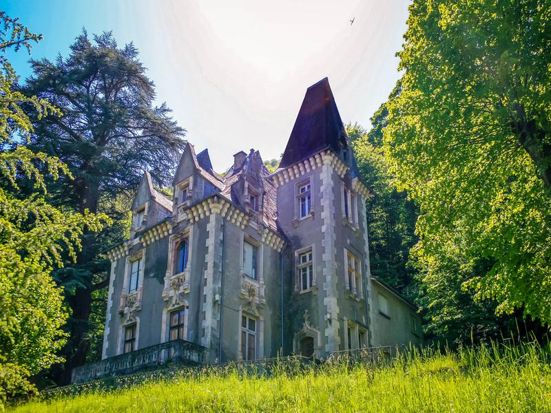 A Stunning gothic style chateau with panoramic views of the picturesque spa town of Bagnères de Luchon and the mountains beyond. Close to amenities, ski resorts and Spain. Offers huge potential. A must see.  A dream renovation project, this fabulous chateau boasts a large drawing room, dining room and 12 bedrooms with a professional kitchen. Many stunning original features including painted ceilings in very good condition still remain.  The chateau can be purchased alone or with the maison de Maitre and the villa situated on the same land.