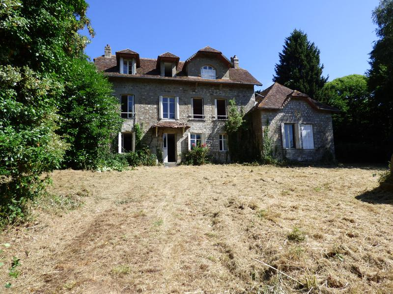 What a fabulous project for your new life in France! This is habitable, but needs a whole lot of tlc to become that perfect country residence.  Whilst the structure and roof are sound there is renovation work to be done - the property is single glazed, the bathrooms are minimal, there is a central heating system fired by oil which requires a new boiler and the drainage does not conform to regulations.  However the spacious layout and setting could provide for a beautiful family home. From the front door you enter into the entrance hall with tiled floor, to the left a snug with fireplace, the hallway leads through to a larder and the kitchen at the rear. To the right of the hallway is the lounge/dining room with fireplace and woodburner with a doorway leading to the 'chapel' which has very high ceilings and a huge feature fireplace.