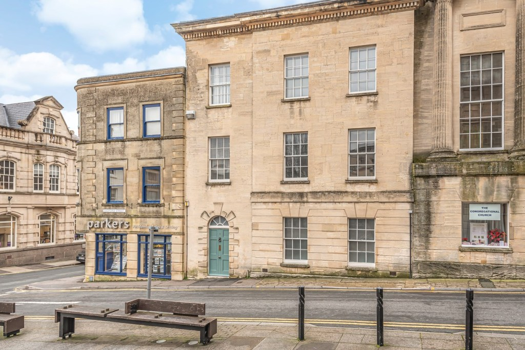 A beautifully-presented town house set in the wonderful community town of Stroud. The property was built in 1835 using Georgian methods and the accommodation is arranged over four floors. On the ground floor, accommodation comprises a wonderful entrance hallway with original flag stone tiled flooring and wooden stair cases, understairs storage, utility room, downstairs w/c, room for (and listed building consent) a downstairs shower room, storage cupboards, 18' sitting room/bedroom with walk in boiler cupboard/wardrobe. On the first floor is a landing, fitted kitchen and an 18' reception room with open fire. On the second floor is the bathroom with shower over bath, an 18' bedroom and 9' bedroom which was previously the hospital chapel and is now home to a bed which has been converted from the old pew. The top floor has been semi-converted to offer a usable attic space which can be used as a hobby room, office or occasional bedroom with storage. This floor also allows for a view over Stroud towards Rodborough. Windows to the front of the property look over the square outside the Subscription Rooms which is often plays home to performances as well as various market stalls from vegetarian and vegan food to florists. The property benefits from gas central heating and secondary glazing as well as a vast amount of character features throughout from original wooden flooring to original sash windows and 10' high ceilings to open fires. The current vendor has improved the property by installing the gas central heating system, renovating the sash windows and installing the secondary glazing, converting the top floor including electrics.