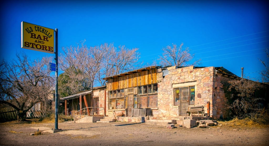 Situated on approximately 1.7 acres this historic Adobe property was once an integral part of the trade here in New Mexico. With well over 8000 ft.² of adobe buildings, this historic property has housed the old saloon, general store, post office, mercantile, stables and hotel since being established as a Butterfield stagecoach stop in the mid 1800s. The historic adobe hotel structure was elegantly remodeled with sustainability and awareness in mind. The courtyard has a fig tree and a pear tree with many places throughout the property for gardens. The home includes 3 bedrooms, 1 bathroom, a south facing sunroom, living room, dining room, kitchen, large pantry/laundry area. It has an amazing well on the back of the property, with the 'best water in the county' (said by many throughout history) - Heating is by LP and a wood burning stove, Cooling is an evaporative cooler. Constructed with double adobe, the walls measure up to 2 foot thick in places, and keep the place very comfortable. The back acre of the property has the ruins of the old stables, blacksmith shop and stagecoach repair garage. It also houses a 600+sqft. container home/studio, and a framed addition added onto it. With water and electrical run to it. Currently used as studio space, and storage - A south facing clerestory provides great light for working - It could easily be finished into a great tiny home or guest apartment or kept as Studio/garage space.