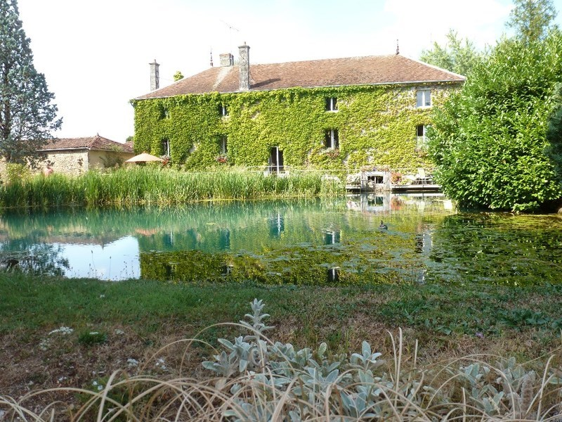 """BRIENNE LE CHÂTEAU sector, very beautiful house, former 17th century mill, Great Lakes region of Champagne (20 km from the lakes of the Orient Forest, 20 km from Lac du Der and its casino). A living area of 285 m² including a living room of 80 m², 5 bedrooms, 4 bathrooms, 2 kitchens. Currently 2 guest rooms (possibility of extension, catering). Ideally located in the center of the """"Station verte 3 fleurs"""" village, you will be able to discover the room of the millstones, the machine room, and the resurgent reach of the Laines. No work needed. Windmill lovers, a must see. The fees are the responsibility of the seller."""