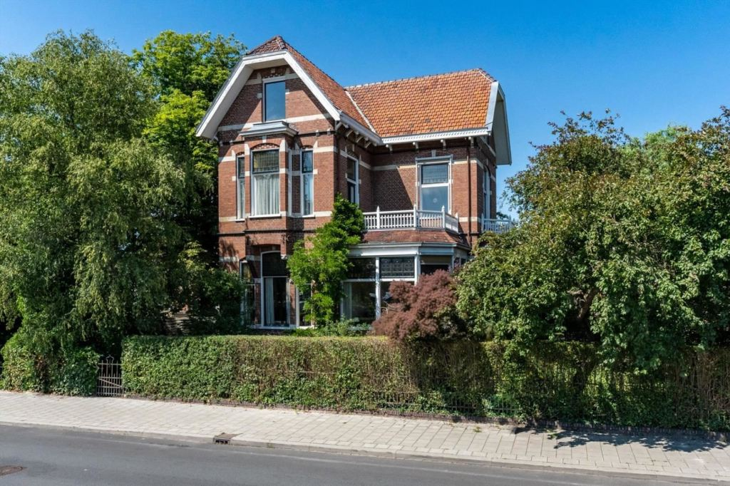 "This beautiful villa has been owned by the same family from construction in 1903 to the present day. The monumental stately architecture-built villa with a rich history, located in a prominent place in the center of Winschoten is offered for sale.  The villa has been built to a design by the Municipality architect Mr. K. de Grooth in a Transitional style with Eclectic, Chalet and Art Nouveau style elements. Many particularly beautiful details have been preserved in the building. It is not without reason that this iconic villa has the status ""National Monument"", a house of general interest, because of its architectural and cultural-historical value."