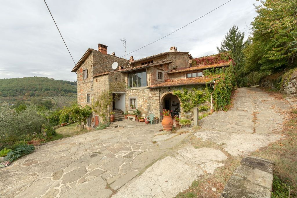 Tuscany Week! A beautiful stone farmhouse with four bedroom, wine-making facilities, and an acre of land (are they grapes or olives?), 40 minutes outside of Florence!