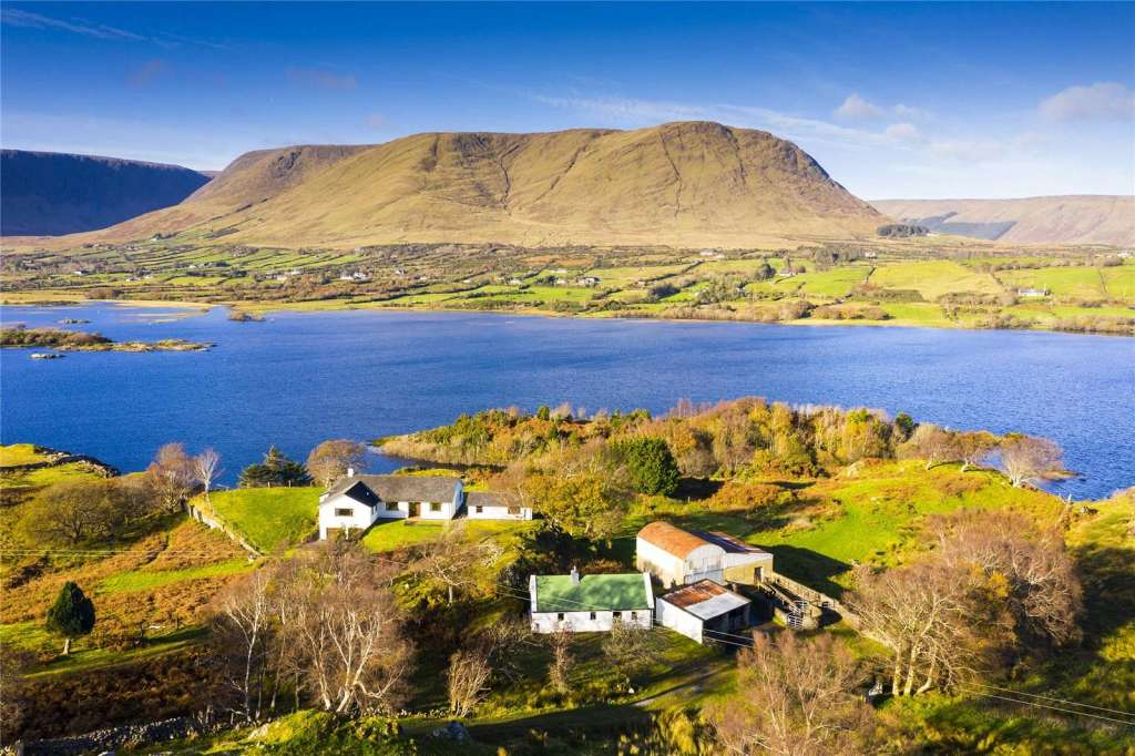Happy Bargain Friday! A homey farmhouse with sweeping vistas on 16+ acres in Maumtrasna, County Mayo, Ireland!