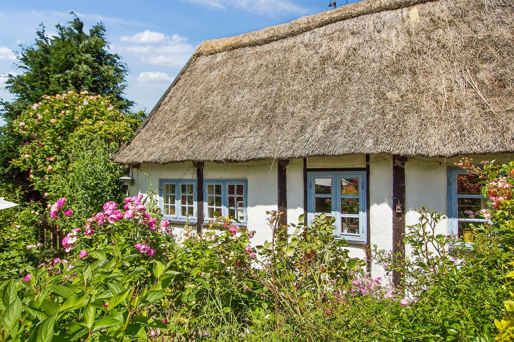 A sweet thatched cottage circa 1688 in a quiet village near the city of Nykøbing, Denmark!