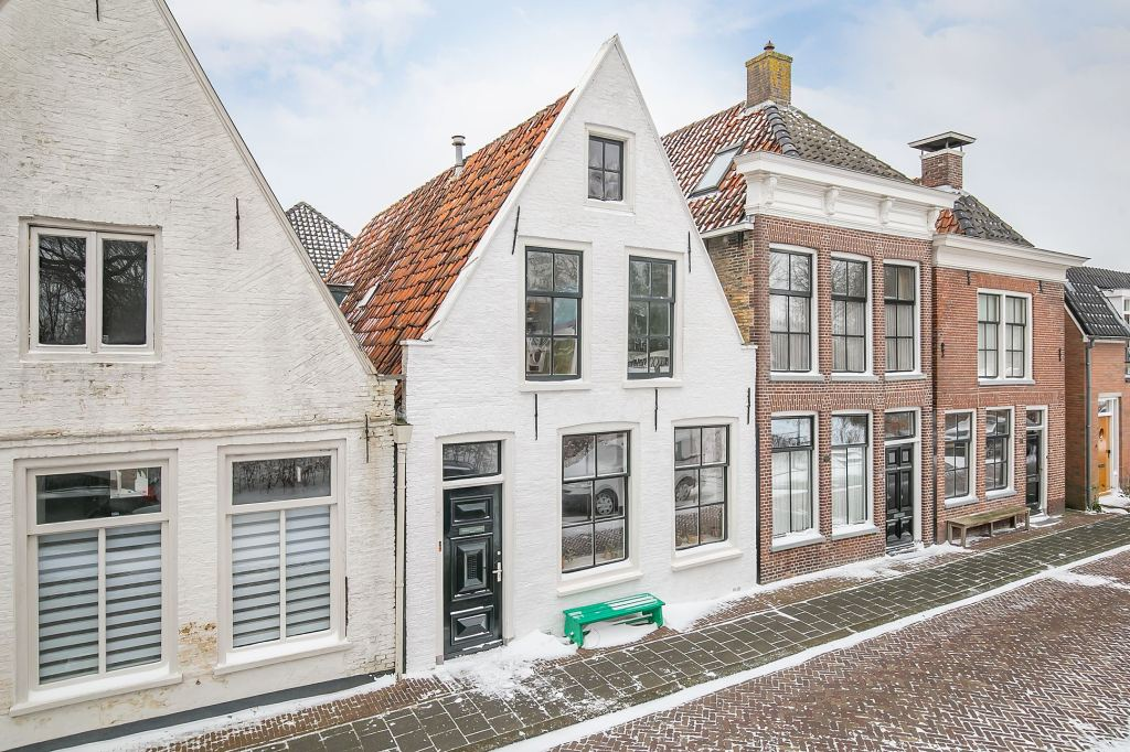 A snowy Dutch townhouse circa 1885 with cute interiors!