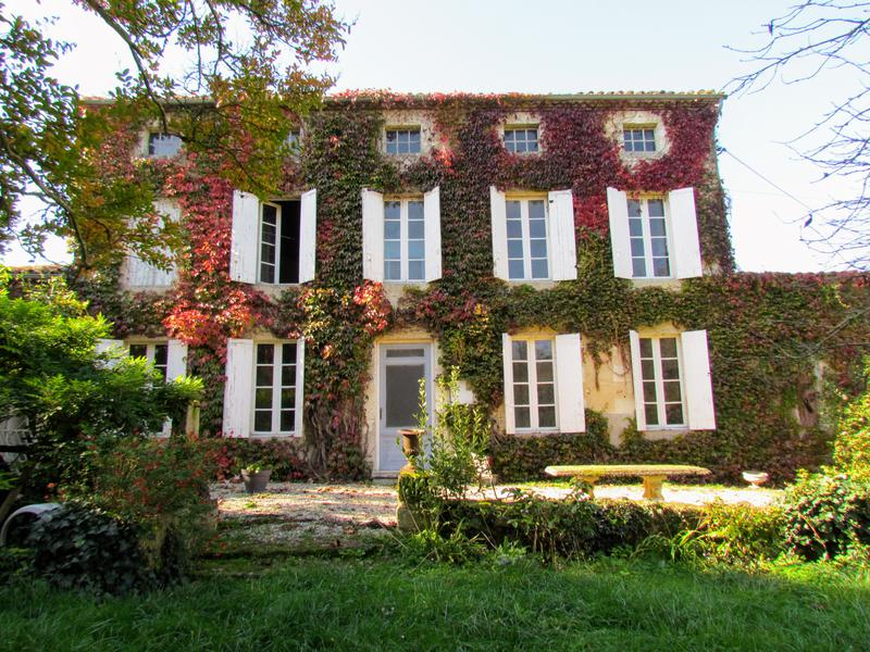 A beautiful equestrian estate with stables set on 21 ACRES of French countryside!