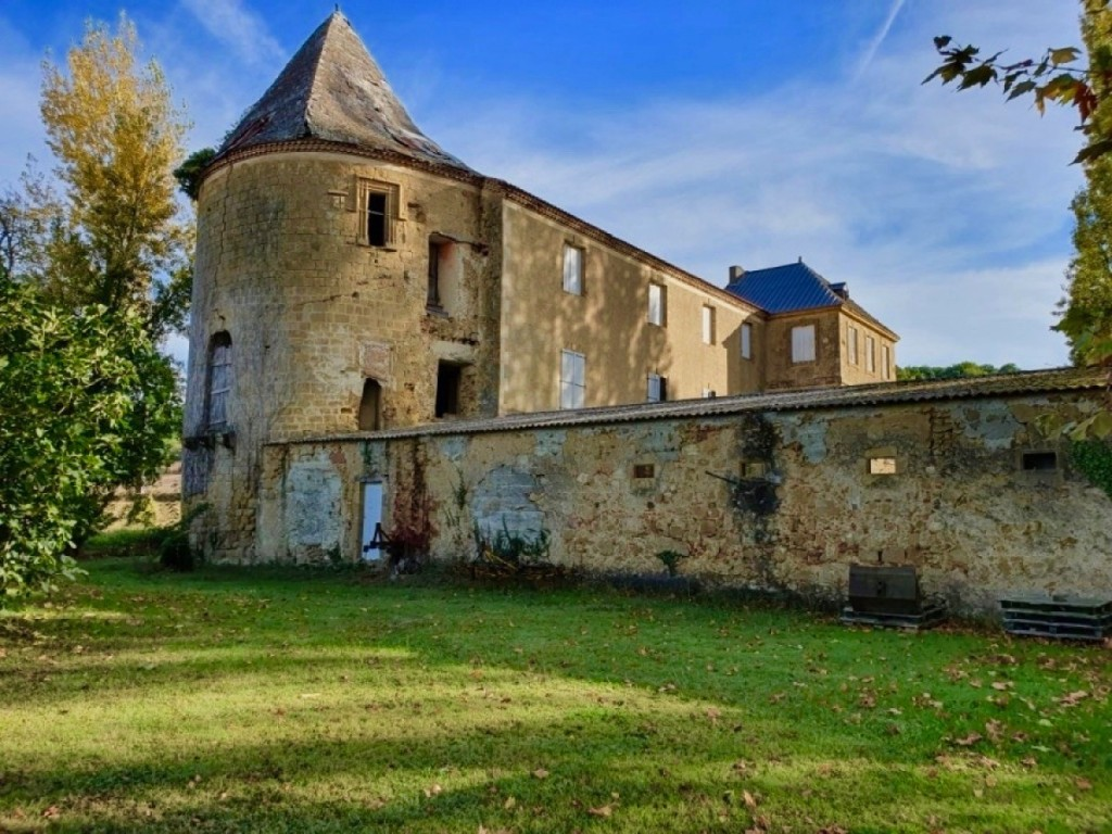 A partially renovated 12th century château on TWENTY NINE acres of land with a spring, located in the Gers, France!