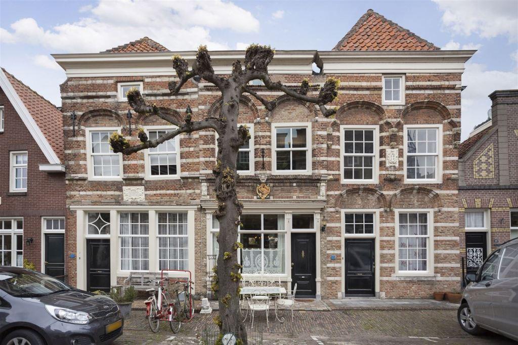 An ornate Dutch home circa 1608 in the center of a pretty village!