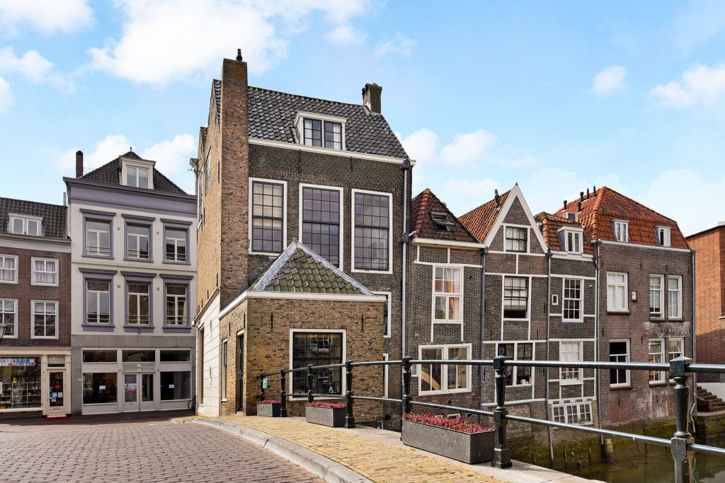 A beautiful three-story historic Dutch home circa 1750 on a bridge over picturesque canal!
