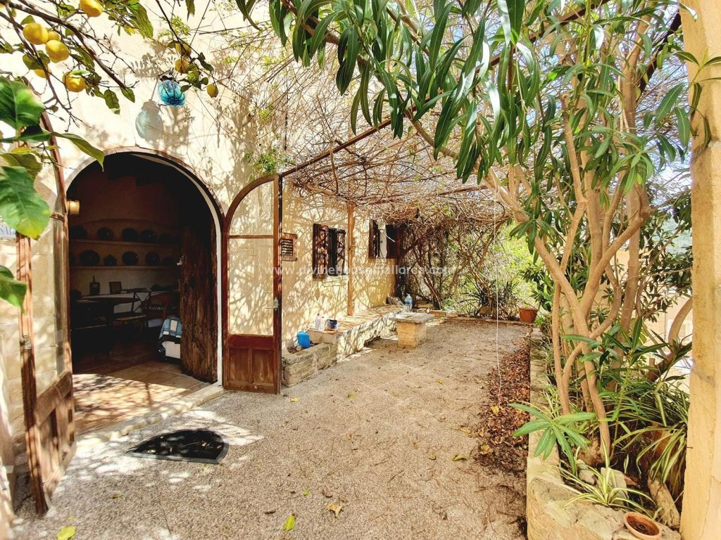 A gorgeous village home circa 1890 at the base of an ancient castle, in Capdepera, Mallorca, Spain!