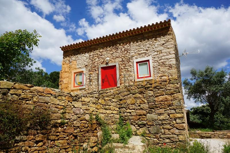 Happy Friday, Escapists! This stone cottage in Portugal may look rustic from the outside, but the interior has been renovated to a beautiful standard. Next to a beautiful river and in a gorgeous area of the country.