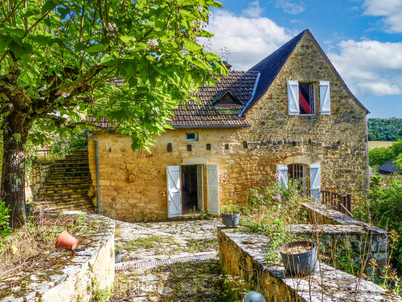An absolutely charming stone village house with castle view in the French countryside, a charming Périgord village called Milhac.