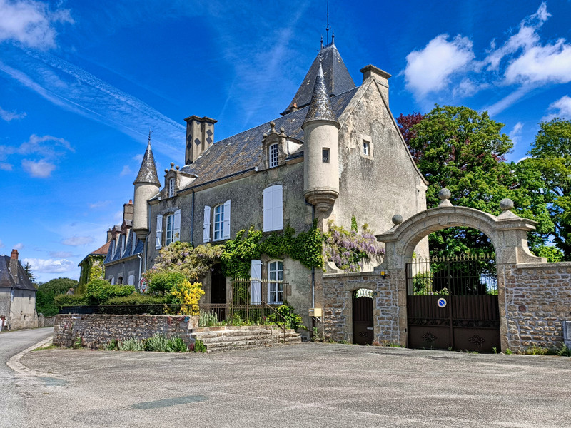 A tiny chateau for sale with origins in the 15th century on two acres, in Les Grands-Chézeaux, a countryside village in Limousin, France.
