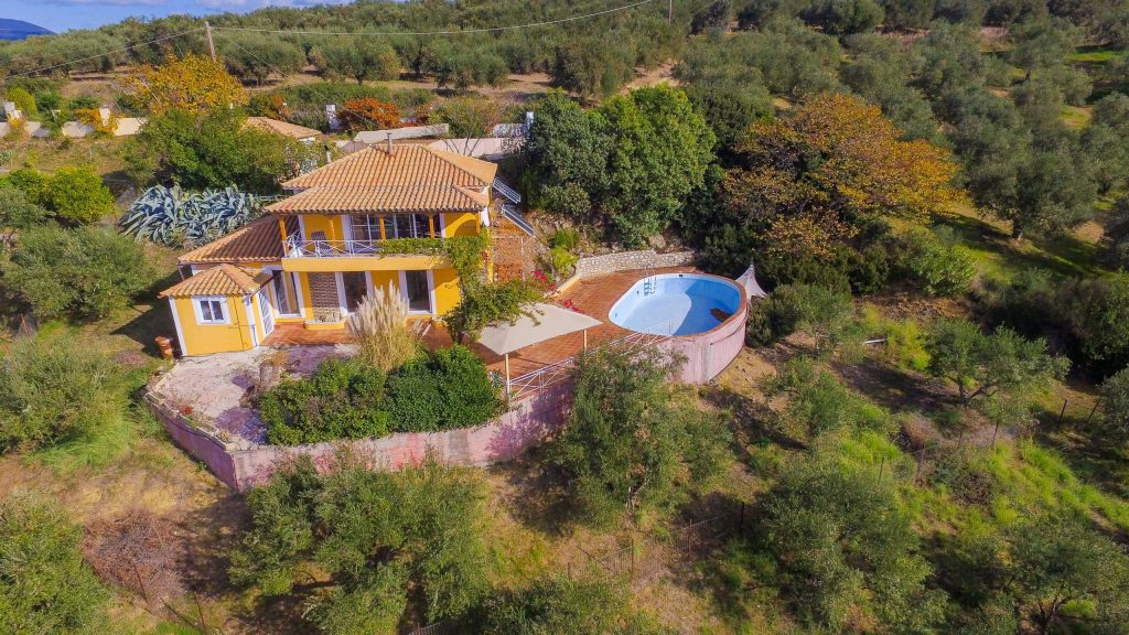 Off-the-grid, furnished Greek villa with a pool and one acre of land, located ten minutes from aquamarine beaches.